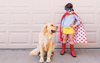 Little girl with cape and dog